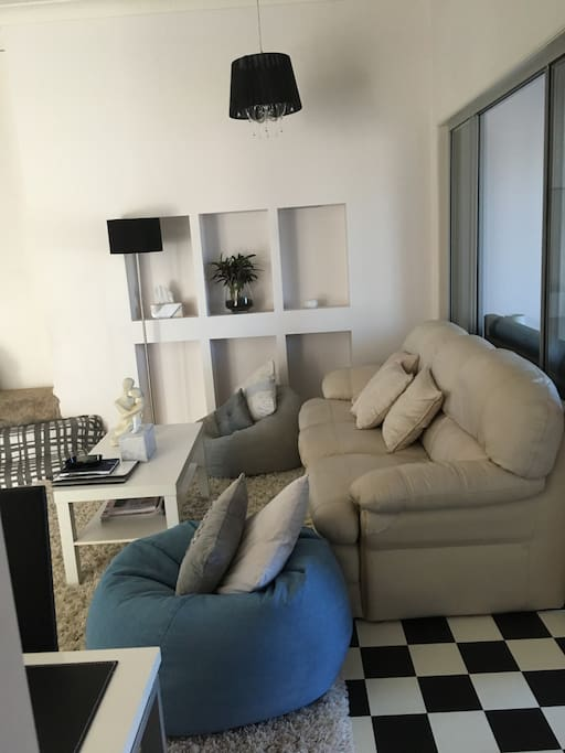 Relaxing air conditioned Lounge / Large TV area