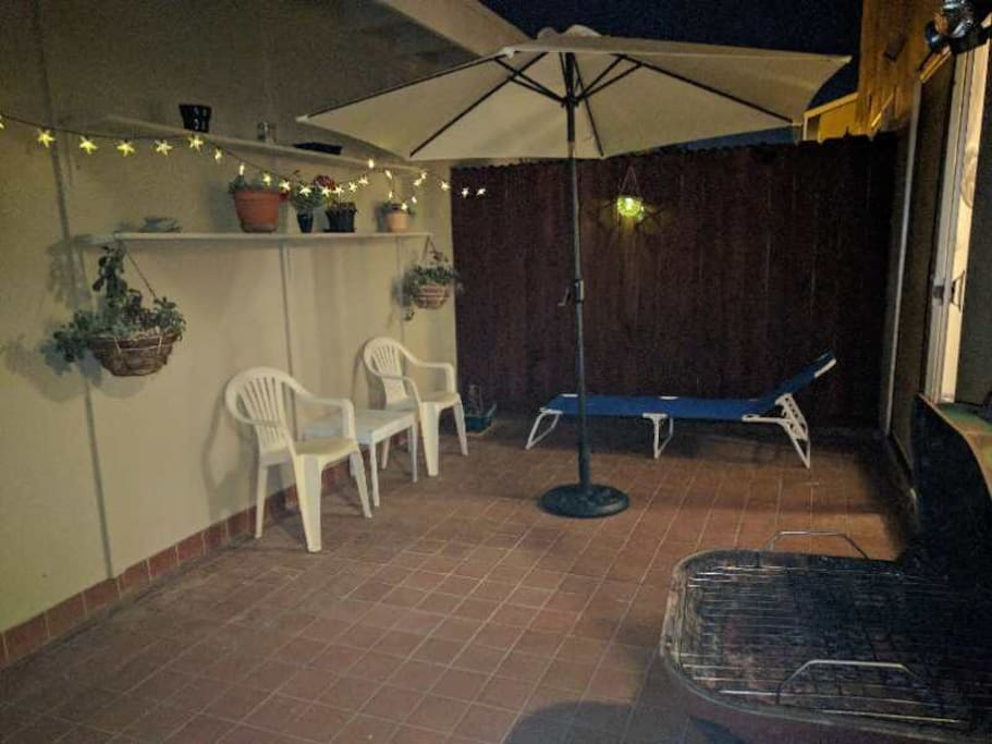 patio with BBQ and solar light.