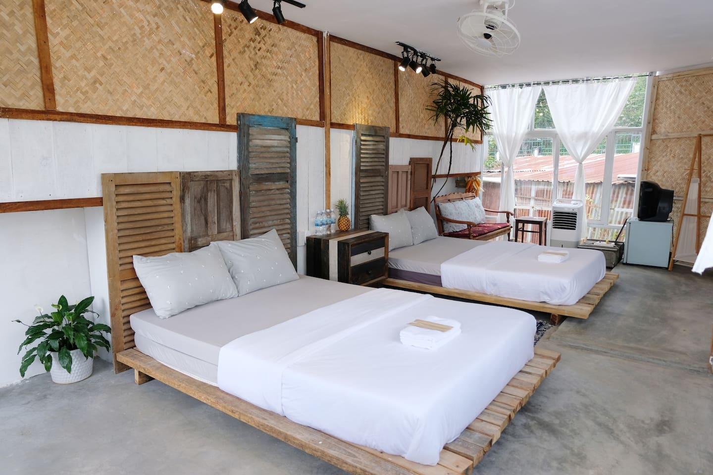 Room G4: 2 double-beds for 4 pax, with inside privated bathroom. guests have to take the wooden stairs outside the house to get in room
