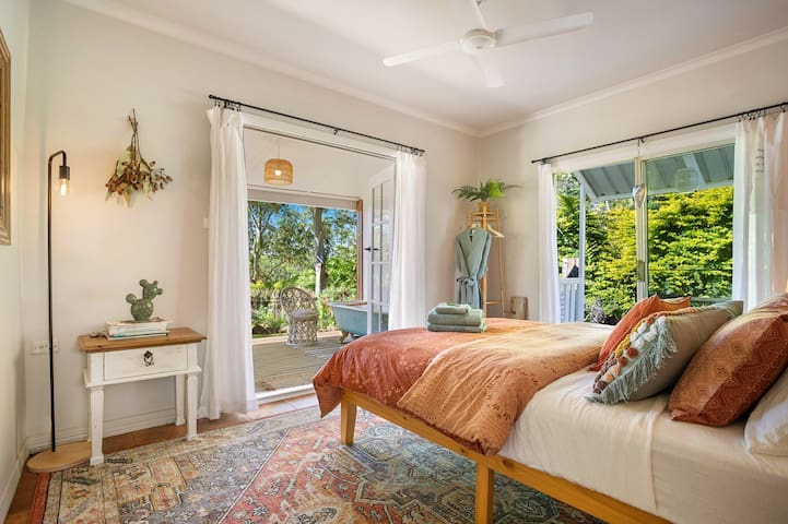 Main bedroom with french doors out to verandah and bath