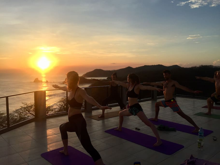 Rooftop yoga during sunset