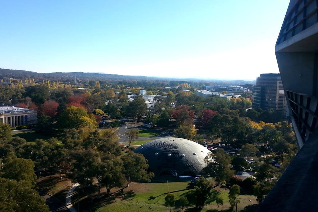 Facing North - Australian National University. The city's on the far right of this photo. It's about a 10-minute walk away, a quick drive or a free bus ride (on weekdays). This photo with autumn colours was taken in May.