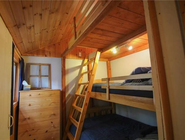 Third Bedroom - Bunkbeds and dresser.....and stairs to the secret room!