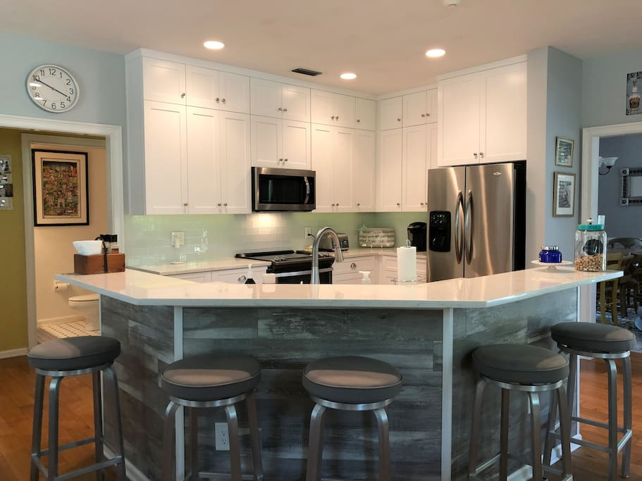 Newly renovated eat in kitchen with 5 barstools