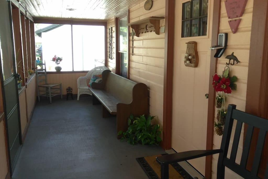 Spacious front porch includes 2 benches.