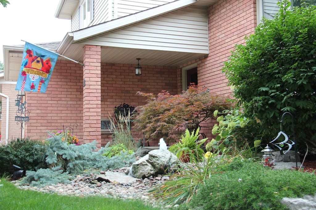 Lush landscaping with relaxing bubbling rock