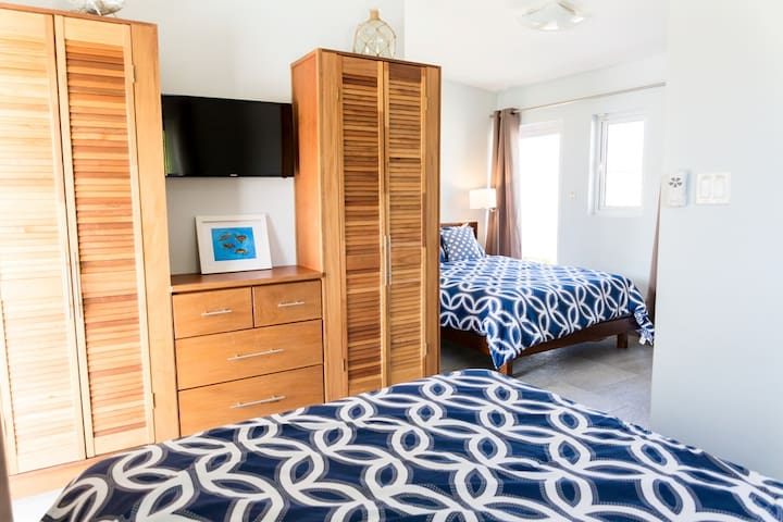 Lock-off bedroom (3rd bedroom) with two Queen beds, private entrance and bathroom