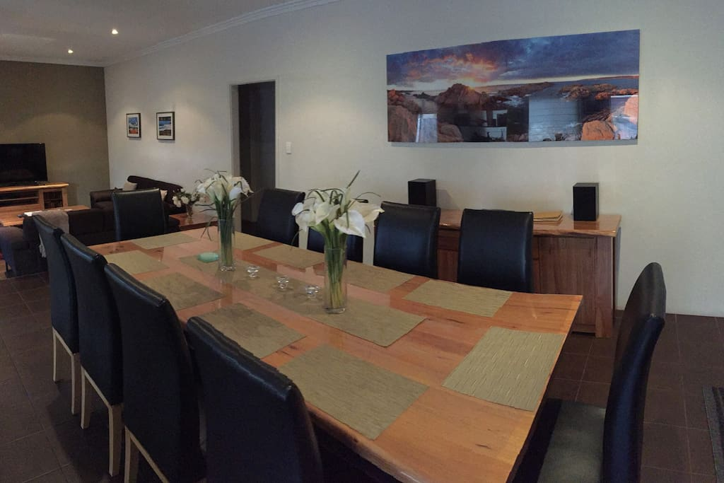 Open plan dining with large dining table, seats 10-12