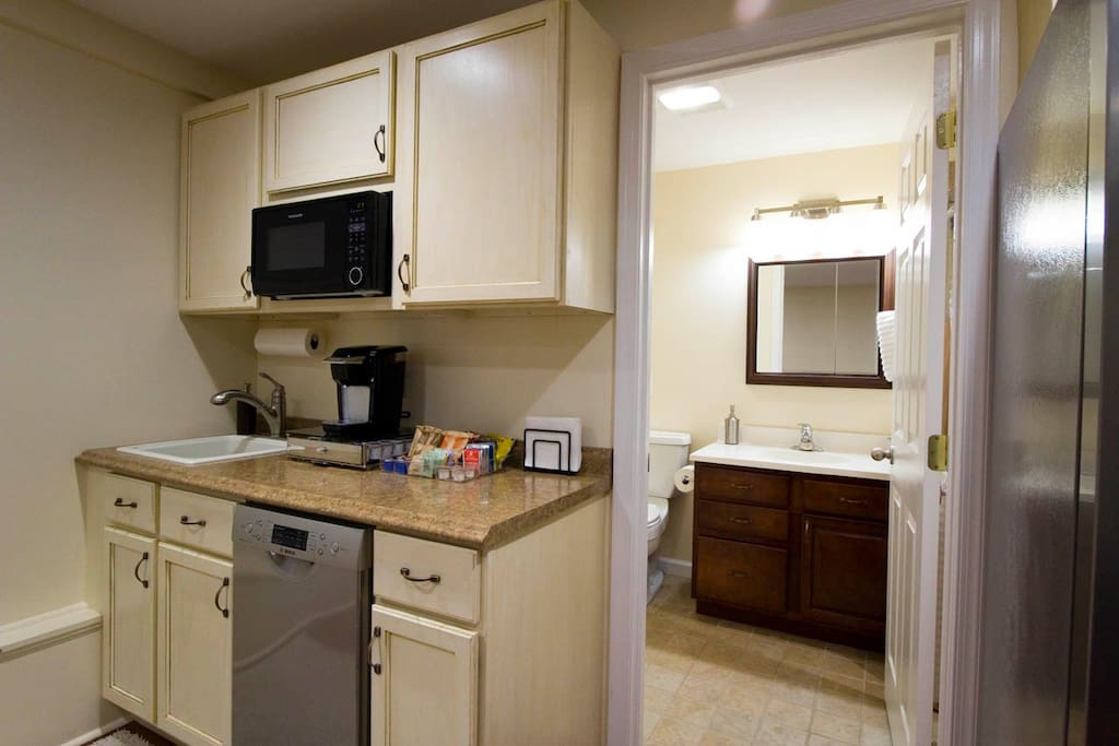 The kitchenette is furnished with microwave, coffeepot, dishwasher, and full size fridge. A toaster oven is available for longer stays.