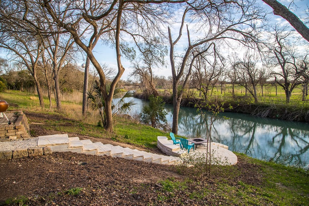 backyard river view limestone deck
