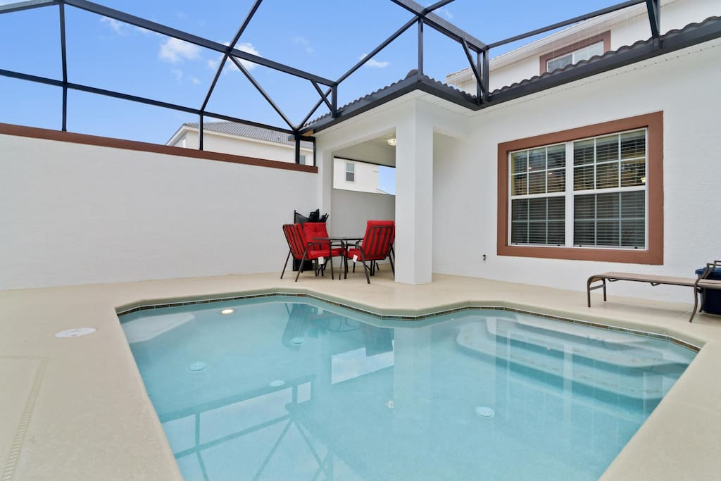 The plunge pool area at this spacious townhome is a great area to relax and take a dip after a long day at the area theme parks.