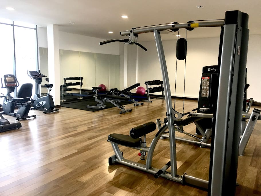 Gym on the top floor, next to the pool and multipurpose hall