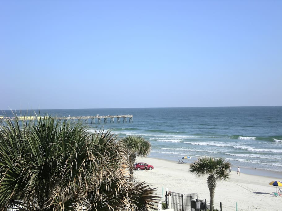 View from our condo of pier & Crabby Joe's