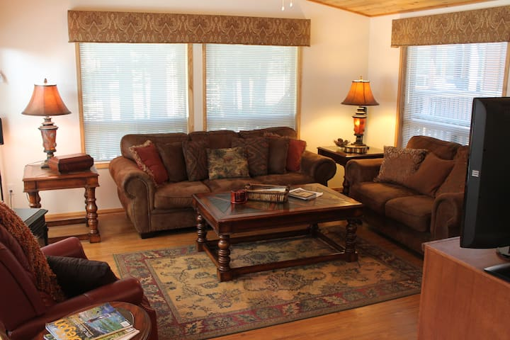 Cozy living room definitely gives you that luxurious cabin stay.