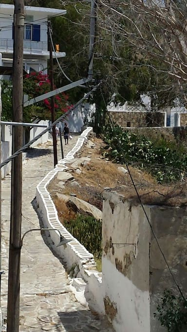 Traditional cycladitic step road. Ten minutes walking lead to main village. Connects Port with Chora (main village).