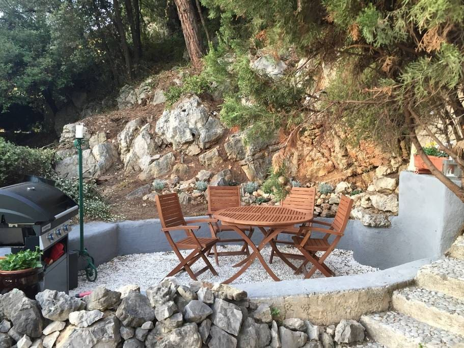 Outdoor seating and BBQ area