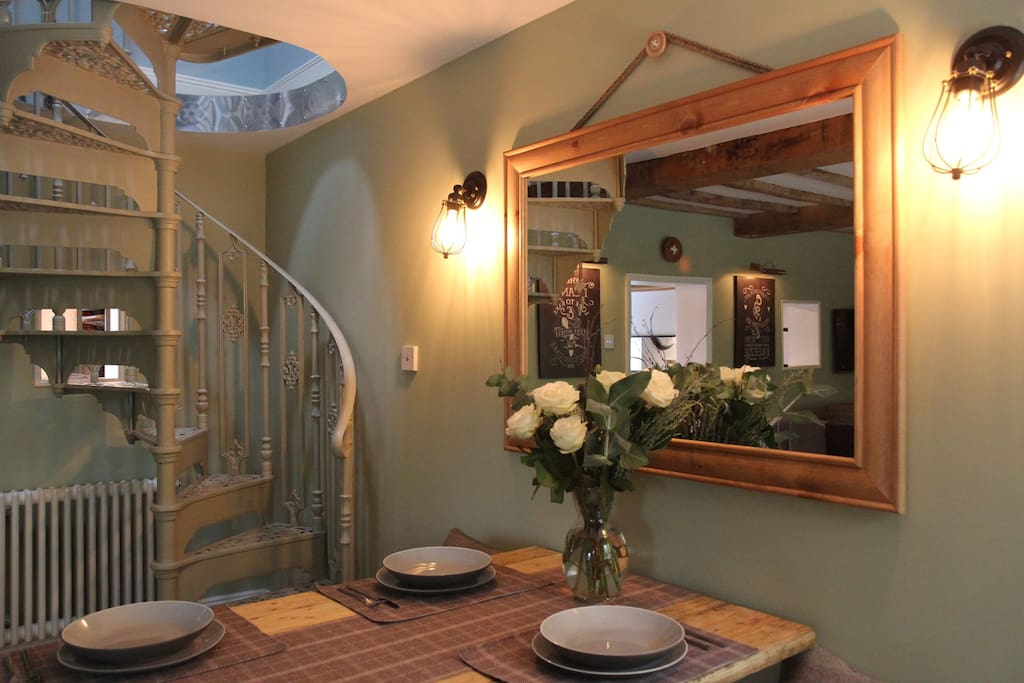 Dining area, with spiral stairs to first floor.