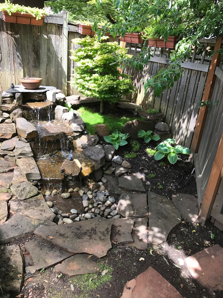 Pondless waterfall next to patio/deck.