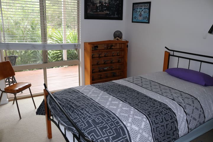 Bedroom with floor (trundle) bed. Note, this room is only available at an extra $40 per person, otherwise, up to two people are classed as twin share and will only have access to the main bedroom (queen bed)