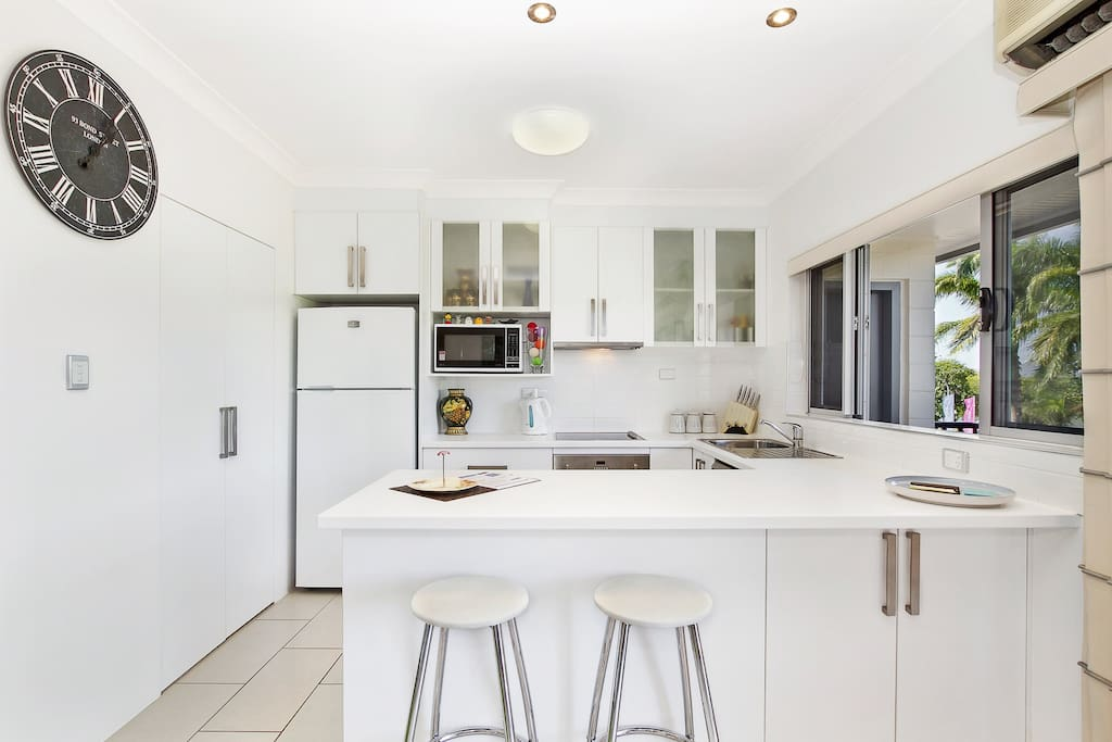 THE KITCHEN IS FULLY STOCKED WITH ALL MODERN EQUIPEMENT. LOOK ACROSS TO THE WATERPARK AND MAGNETIC ISLAND WHILE IN THE KITCHEN.