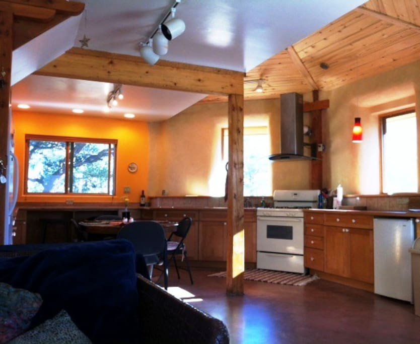 Large open kitchen with solar heated floor. Desk area with view.