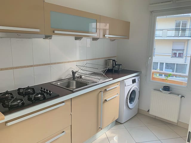 Kitchen with all utensils, kettle, French press and washing machine