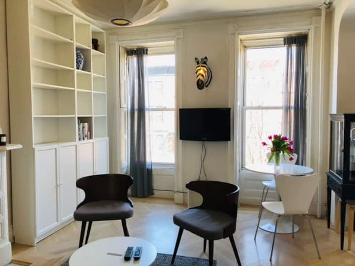 Bright one Bedroom with European Flair