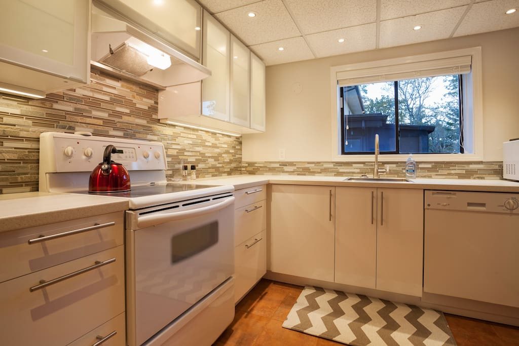 Brand new kitchen with complementary coffee, full stove, oven, microwave, dishwasher, laundry.