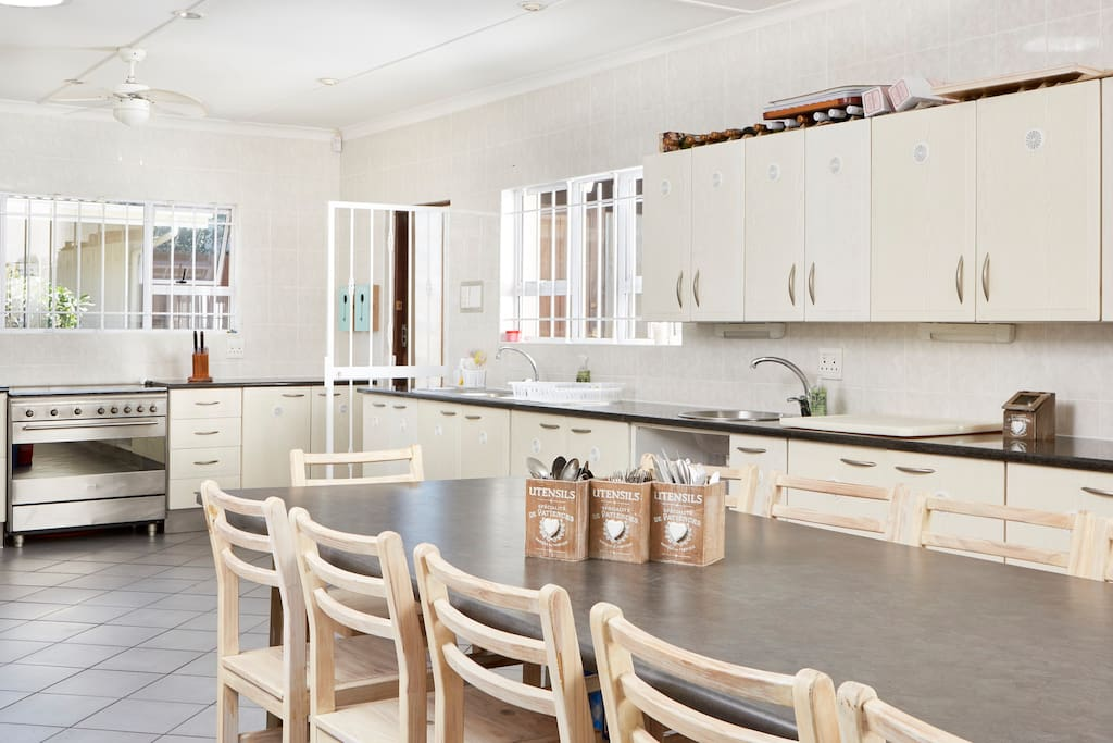Open plan expansive kitchen with a 14-16 seater dining table
