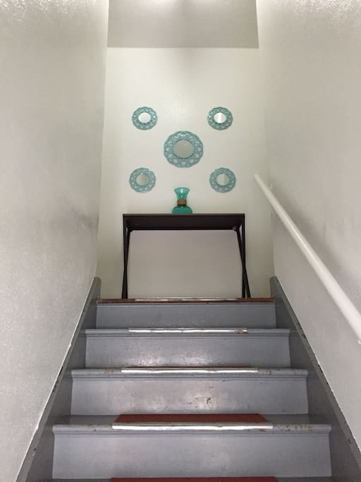 The stairs leading to your unit