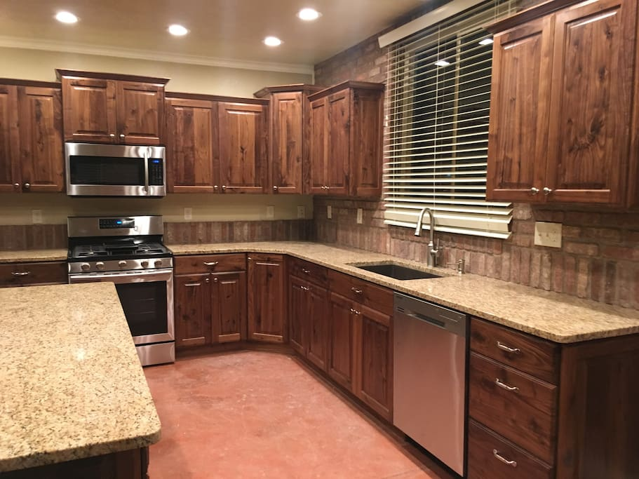 Brand new cabinets, granite and stainless steel appliances