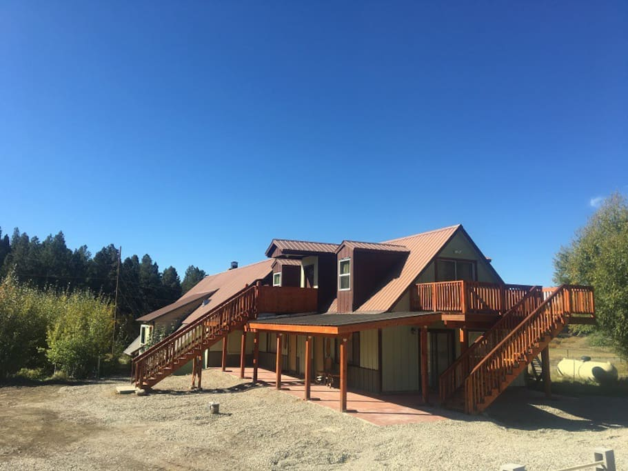 Song Spring Lake lower level bungalows feature a large porch. The upper bungalow has a large deck with a great view.