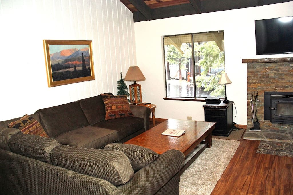 Mammoth Lakes Vacation Rental Sunshine Village 150 - upgraded living room with a flat screen TV and woodstove