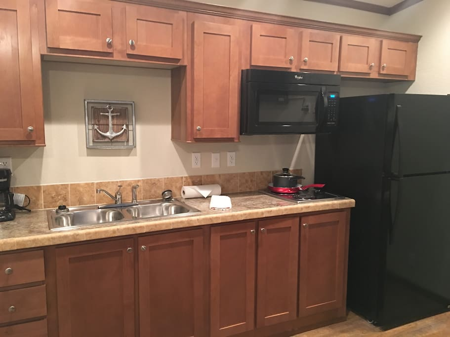 Kitchenette with full-size refrigerator, microwave and dual electric range