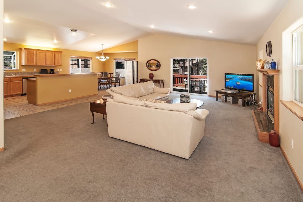 Open floor plan with a large living room, kitchen, and dining area