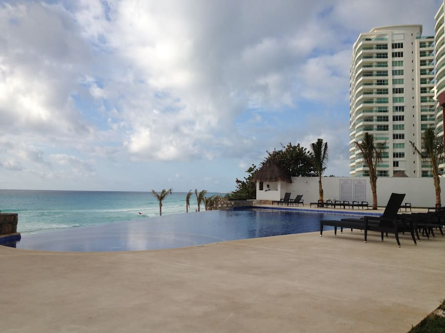 New additional pool area with infinity pool, loungers, showers and direct access to the private beach