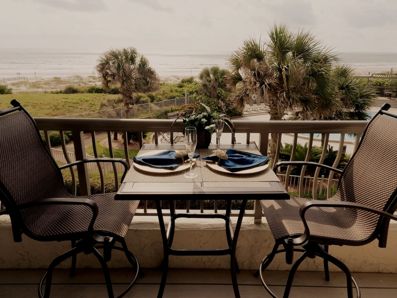 """Oceanfront balcony. """"Loved sitting on the balcony right on the ocean. Very short pathway to beach. Convenient to restaurants and shops on the resort. Communication was awesome. We loved being there and would do it all over again in a heartbeat!"""""""