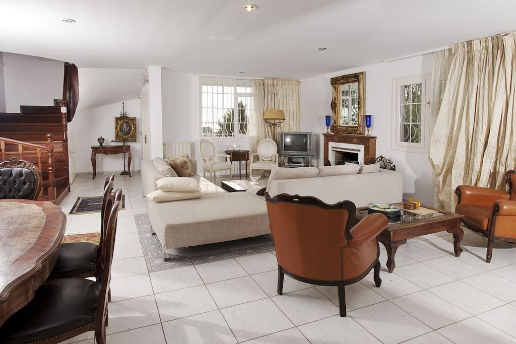 A spacious living room with direct access to the garden