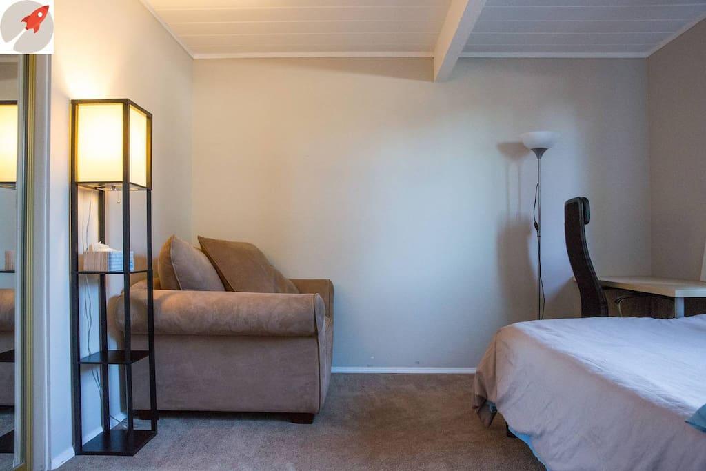 Room has a big comfy chair