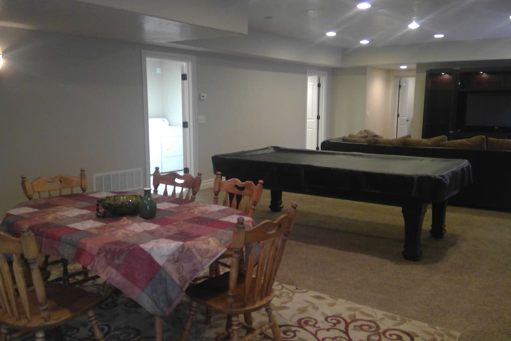 Great room; dining table, pool table, large TV/cabinets