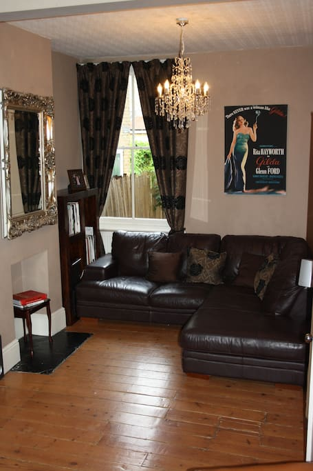 Large lounge with 2 substantial areas to relax, including a large and comfortable sofa