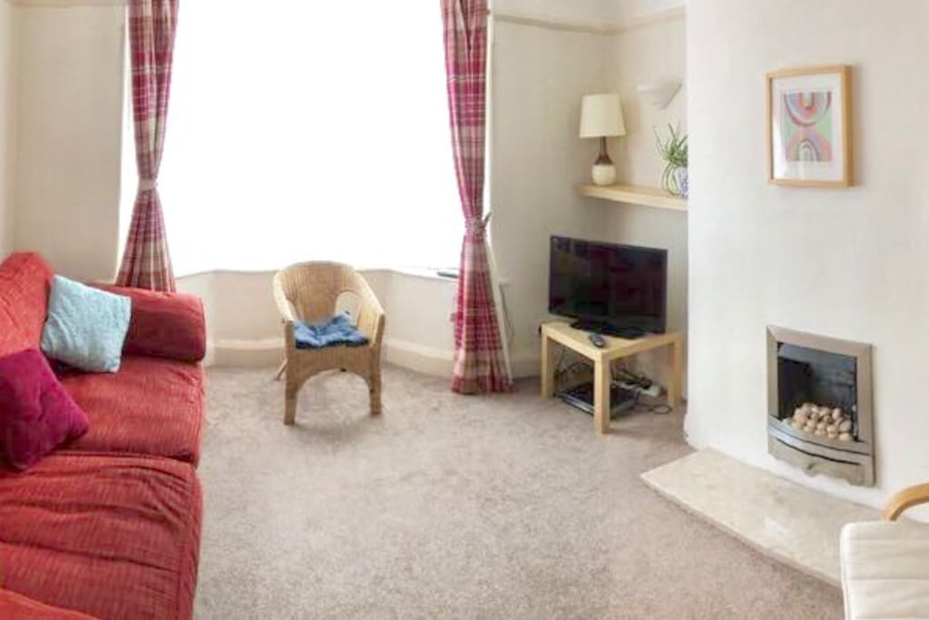 Light sunny living room overlooking free parking outside