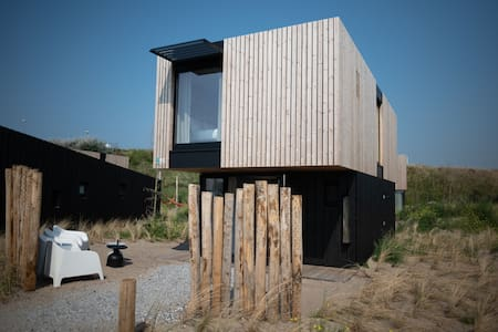 Modern lodge with two bathrooms, 100m from the sea