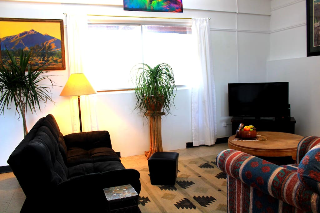 Living room of guest house including the couch-futon on the left.