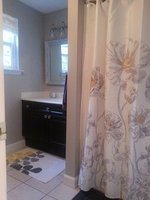 Private full bath with shower. Towels and amenities provided.