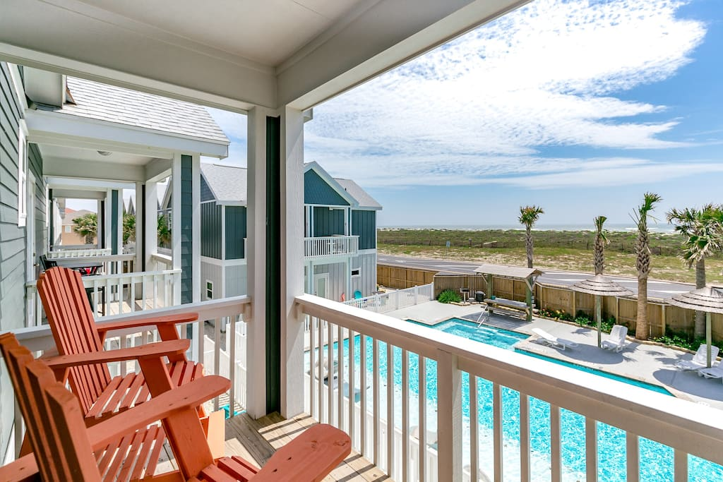 The master bedroom balcony looks out over the pool and dunes.