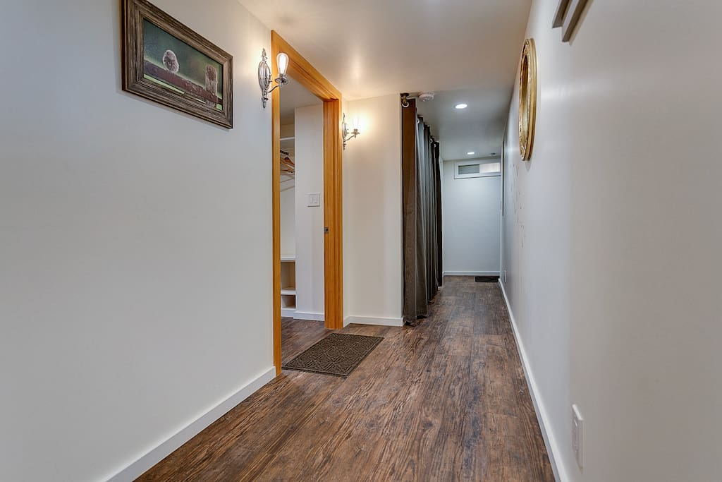 The downstairs hallway leading to the studio entrance on the left