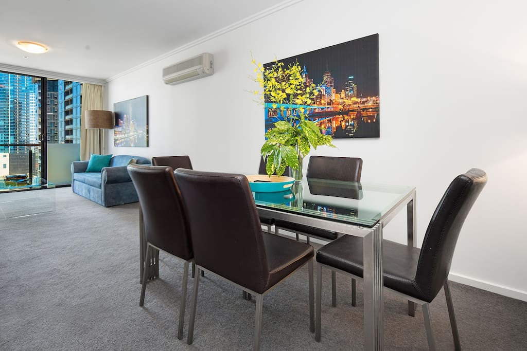 Dining area with quality furniture in this StayCentral Bayviews serviced apartment