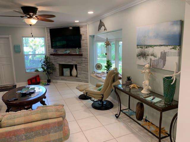 Living room with full size couch that converts into a sofa bed and love seat.  Reclining chair with ottoman.  65 inch TV with cable programing, Amazon, Netflix and many other online options.