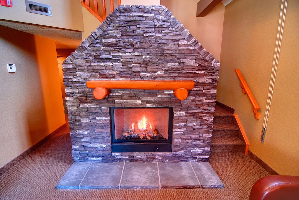 Snuggle your loved one in front of the majestic gas fireplace.